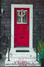 Colorful Easter Egg Wreath On A Front Red Door.