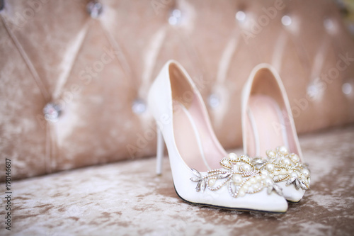 Elegant and stylish bridal shoes. Selective focus. Wallpaper Mural