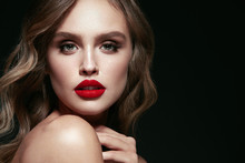 Beauty Face. Beautiful Woman With Makeup And Red Lips.