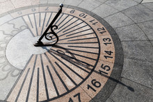 Outdoor Urban Sundial On Stone Pavement