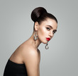 Fashion Portrait of Young Woman with Retro Styling Hair Bun Hairstyle and Eyeliner Makeup