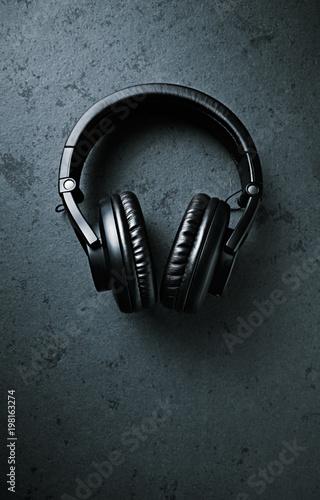 Black Headphones on dark stone background; seen from above Canvas Print