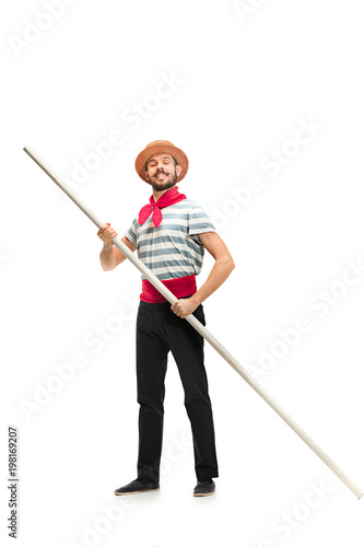 Tablou Canvas Caucasian man in traditional gondolier costume and hat