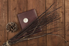 An Overhead Photo Of A Handmade Broom With A Book Of Shadows, A Candle, And Copy Space