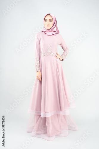 Garden Poster Beautiful muslim girl wearing pink asian dress known as Baju Kurung with Hijab.Hijab fashion for Eid Mubarak.Studio Shoot.