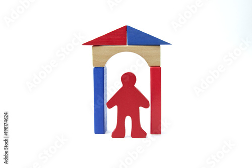 Figure Red Stick Man Under A Wooden Archway With The Roof Of The