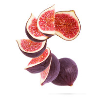 Figs Cut Into Pieces On A Whit...