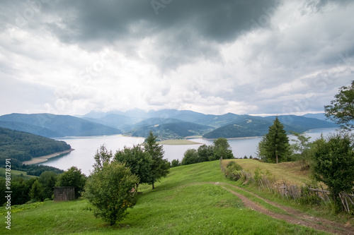 Fotobehang Wit Cloudy landscape view from Lake Bicaz in Romania