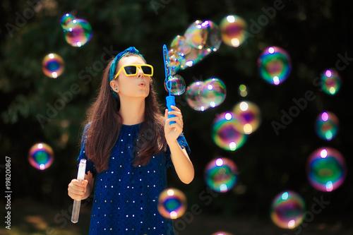 Summer Woman Having Fun Making Soap Bubbles