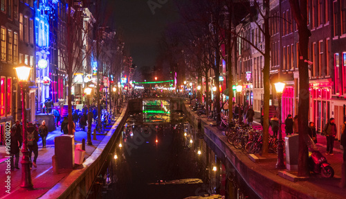 fototapeta na ścianę Amsterdam red district prostitution quarter street, canal at night
