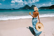 canvas print picture - Girl relaxing on the tropical beach in Asia