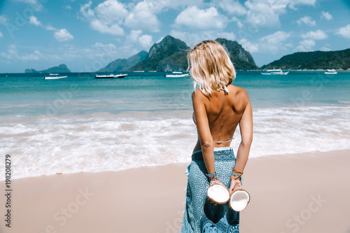 Foto op Canvas Bleke violet Girl relaxing on the tropical beach in Asia