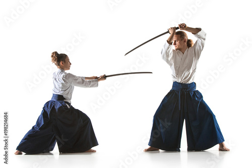Man and woman fighting and training aikido on white studio background Wallpaper Mural