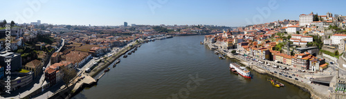 Photo Stands Ship Panoramic image of the Douro River in Porto, Portugal. The image was made on the Dom Luis Bridge. The Douro River separates the cities Porto and Vila Nova de Gaia.