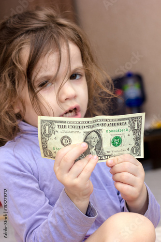 Young kid girl holding money in hands Canvas Print