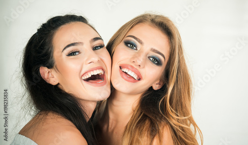 Photographie  Two young girlfriends having fun