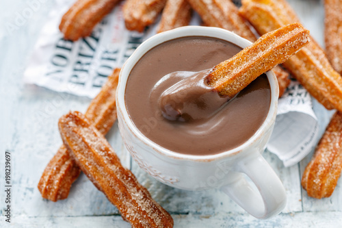 Spoed Foto op Canvas Chocolade Traditional Spanish dessert churros.