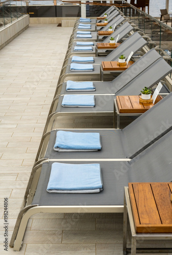 Spoed Foto op Canvas Trappen Row of loungers on cruise ship deck