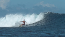 Extreme Male Surfboarder Carve...