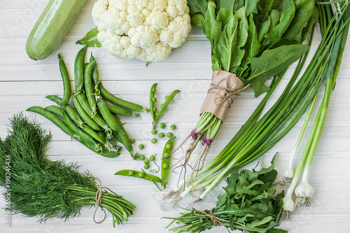 Composition on a dark background of green organic vegetarian products