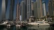 Boats moored in Dubai Marina and skyscrapers