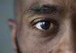 Leinwandbild Motiv Closeup of an eye of a black man