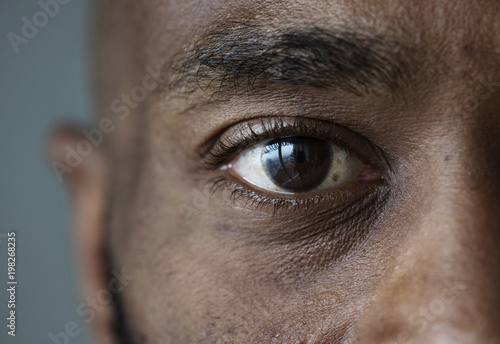 Closeup of an eye of a black man Fototapet