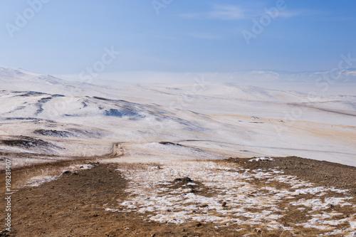 Staande foto Vulkaan Road with snow in winter season at Olkhon Island