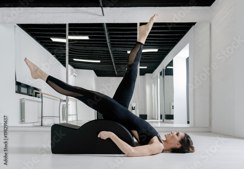 Photo  A Woman Doing Pilates Exercise