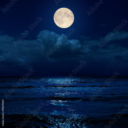 Poster Rivière de la forêt full moon in night over clouds and sea with reflections