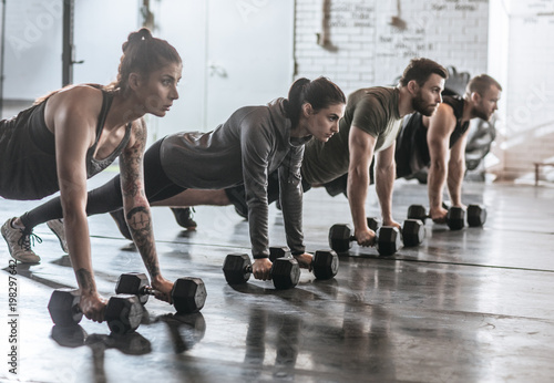 Sportspeople Doing Pushups at Gym