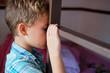 Vascular hemangioma boy cheek. Sad grim child. Concept: medicine, childhood diseases