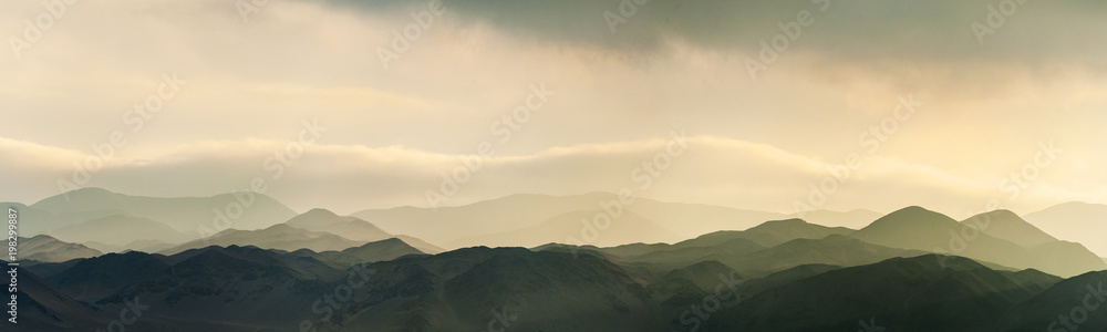 Fototapety, obrazy: Amazing sunset sunrise and low clouds over the hills of Reserva Nacional La Chimba, as seen from La Portada
