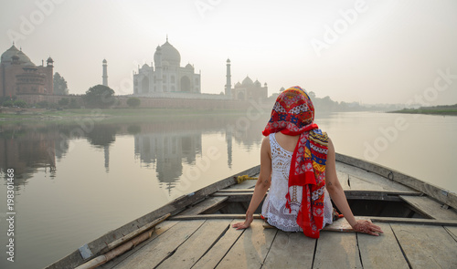A woman watching sunset over Taj Mahal Canvas Print