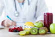 Leinwandbild Motiv Some fruits such as apples, kiwis, lemons and berries on nutritionist table.