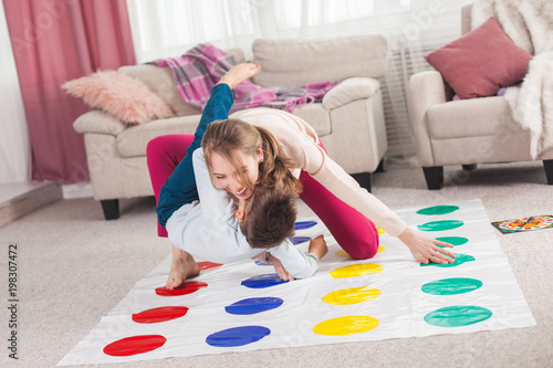 Young mother playing twister with her son Canvas-taulu