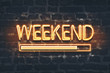 canvas print picture - Weekend loading neon sign on dark brick wall background