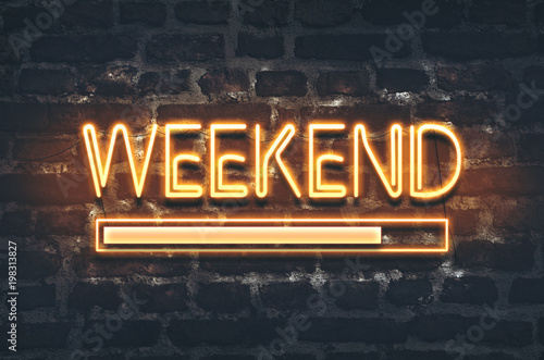 Weekend loading neon sign on dark brick wall background Fototapet