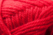 Closeup Of Ball Of Red Wool Yarn Texture