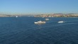 Ships floating Bosphorus blue water sunny day. Aerial drone view on sunset in Istanbul, Turkey