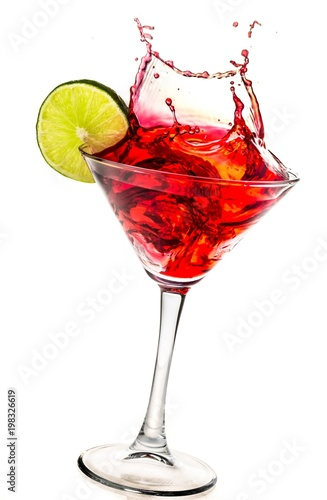Foto Splashing Cocktail on white background