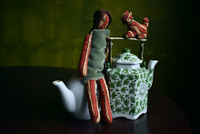 Rag Doll Sitting On A Teapot