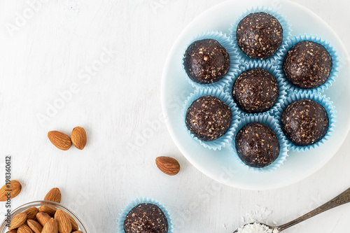 Chocolate energy bites with nuts, cocoa powder, dates and coconut flakes.