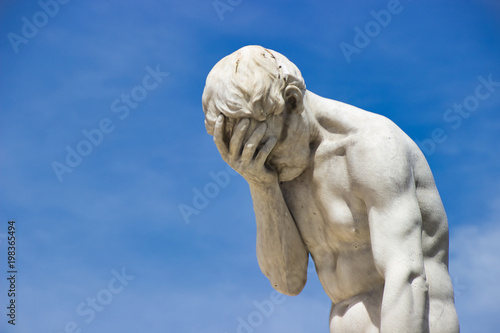 Desperation. Guilt. Facepalm Statue of Cain by Henri Vidal, Jardin des Tuileries, Paris
