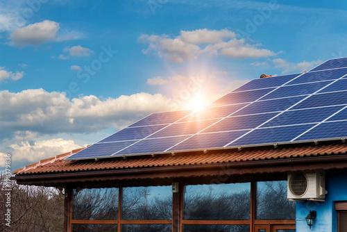 Obraz Solar panel on a red roof - fototapety do salonu