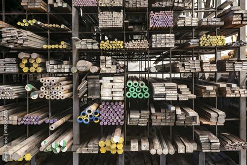 Fotomural Stacked steels in metal warehouse