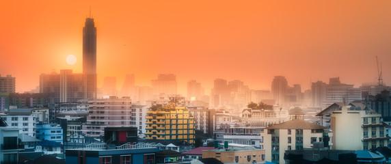 Fototapeta Sunset cityscape with skyscrapers Bangkok