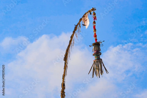 Penjor - Symbol Thanks and Greatness of God view on blue sky