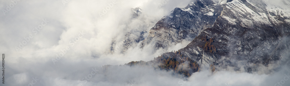 Fototapeta Aerial image of beautiful mountain landscape with clouds in the Valais Kanton