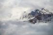 Leinwandbild Motiv Aerial image of beautiful mountain landscape with clouds in the Valais Kanton